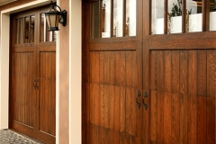 Image of three seperate garage doors on a luxury home